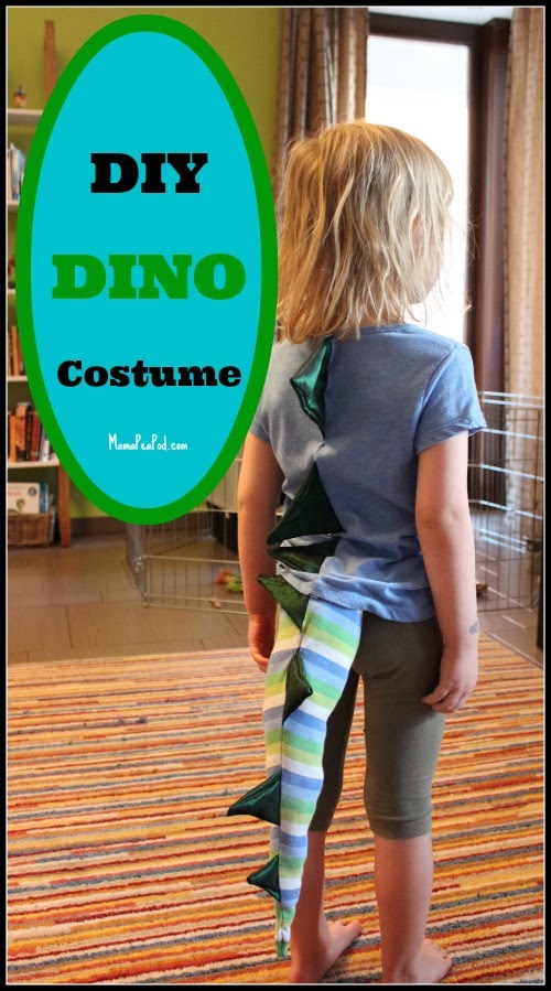 child wearing a DIY homemade dinosaur costume for dress up play