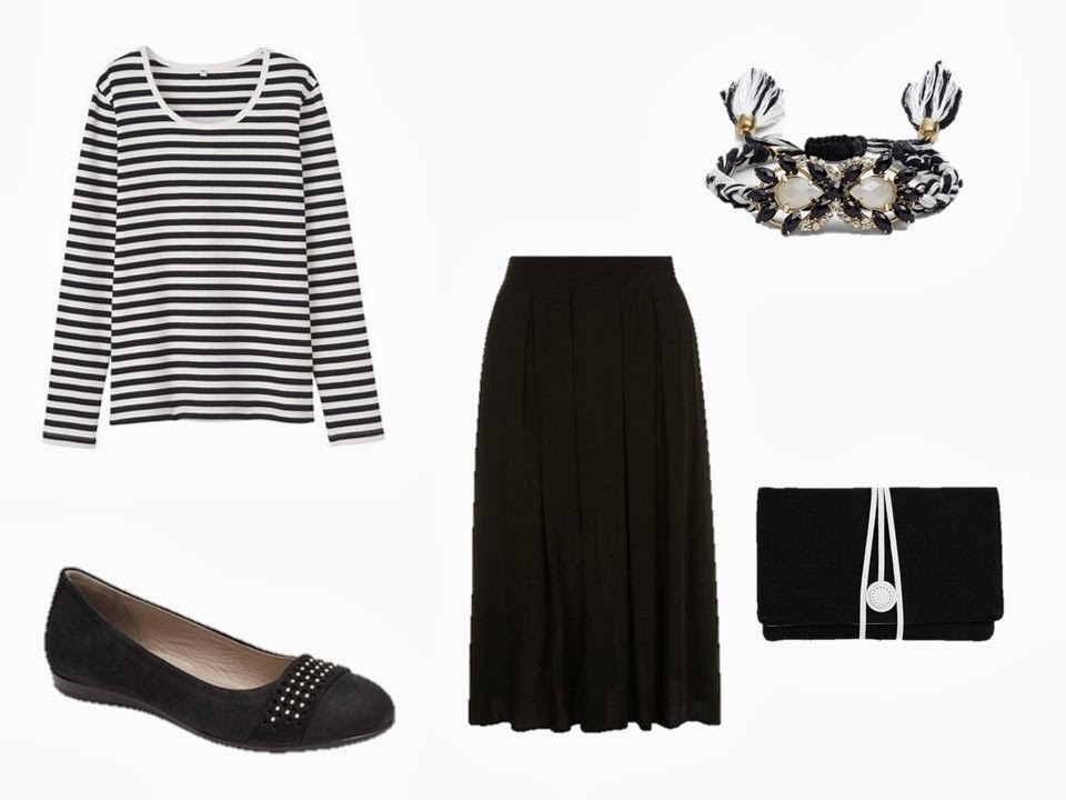 a black and white long sleeved tee shirt, worn with a black skirt and black ballet flats