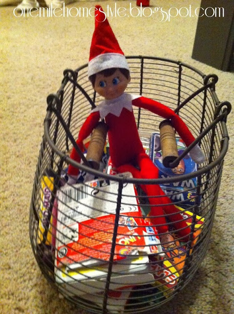 Elf on the Shelf in a basket of playing cards