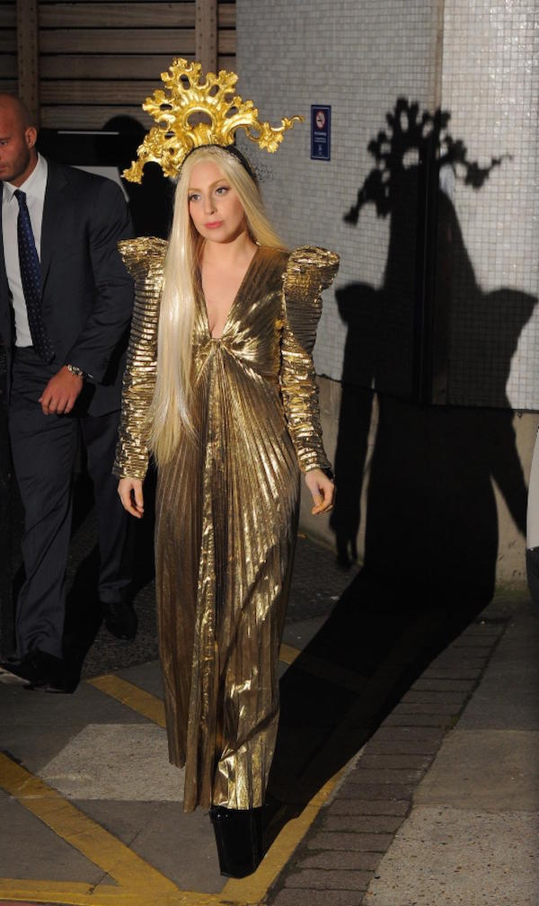 Lady Gaga is shing star, she is wearing golden outfit with gold vintage crown when she leaving ITV studios in London.