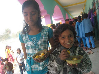 A little girl and boy at the Shekhwara Village School during lunch time