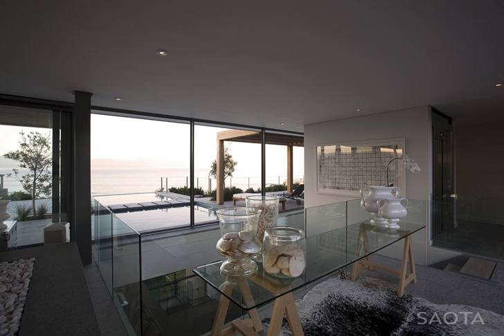Glass railing in Beautiful Plett 6541+2 Home by SAOTA