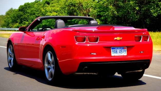 Rear 3/4 view of 2011 Chevrolet Camaro SS Convertible driving with top down