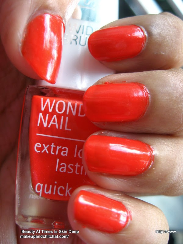 Nail swatch of  Isadora Wonder Nail Quick Dry Nail Polish 774 orange Flash
