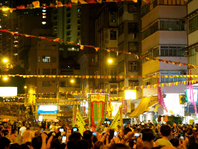 Streets crammed with people, flags and lanterns | Tai Hang Fire Dragon Dance during Hong Kong Mid-Autumn Festival
