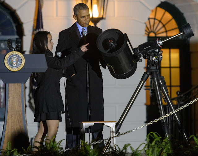 Agatha Sofia Alvarez-Bareiro, a student from Brooklyn, NY, left, points out parts of a telescope to President Barack Obama during the second White House Astronomy Night on Monday, Oct. 19, 2015. The second White House Astronomy Night brought together students, teachers, scientists, and NASA astronauts for a night of stargazing and space-related educational activities to promote the importance of science, technology, engineering, and math (STEM) education. Photo Credit: (NASA/Joel Kowsky)