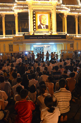 Death of King Norodom Sihanouk, mourners at Sihanouk portrait at Royal Palace, Phnom Penh, Cambodia