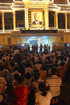 Death of King Norodom Sihanouk, mourners at Sihanouk portrait at Royal Palace, Phnom Penh, Cambodia