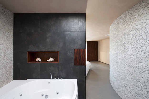 Photo of minimalist bathroom interiors with round walls
