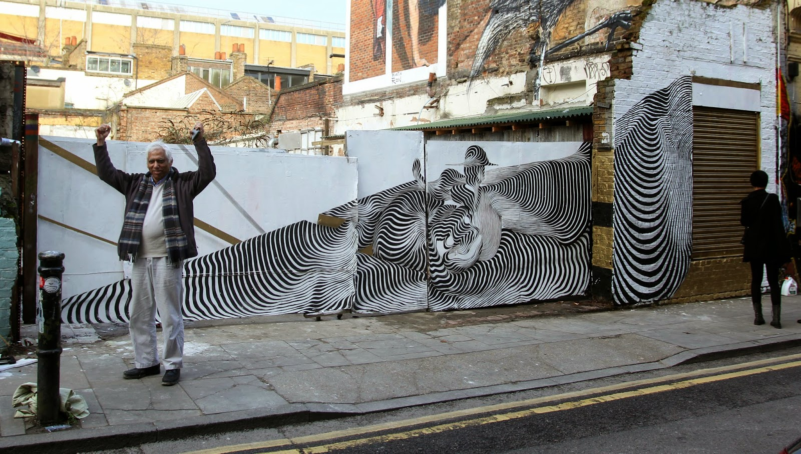 Armed with his paintbrushes, the Italian street artist braved the cold weather to paint some of his signature abstract imagery in East London. 1
