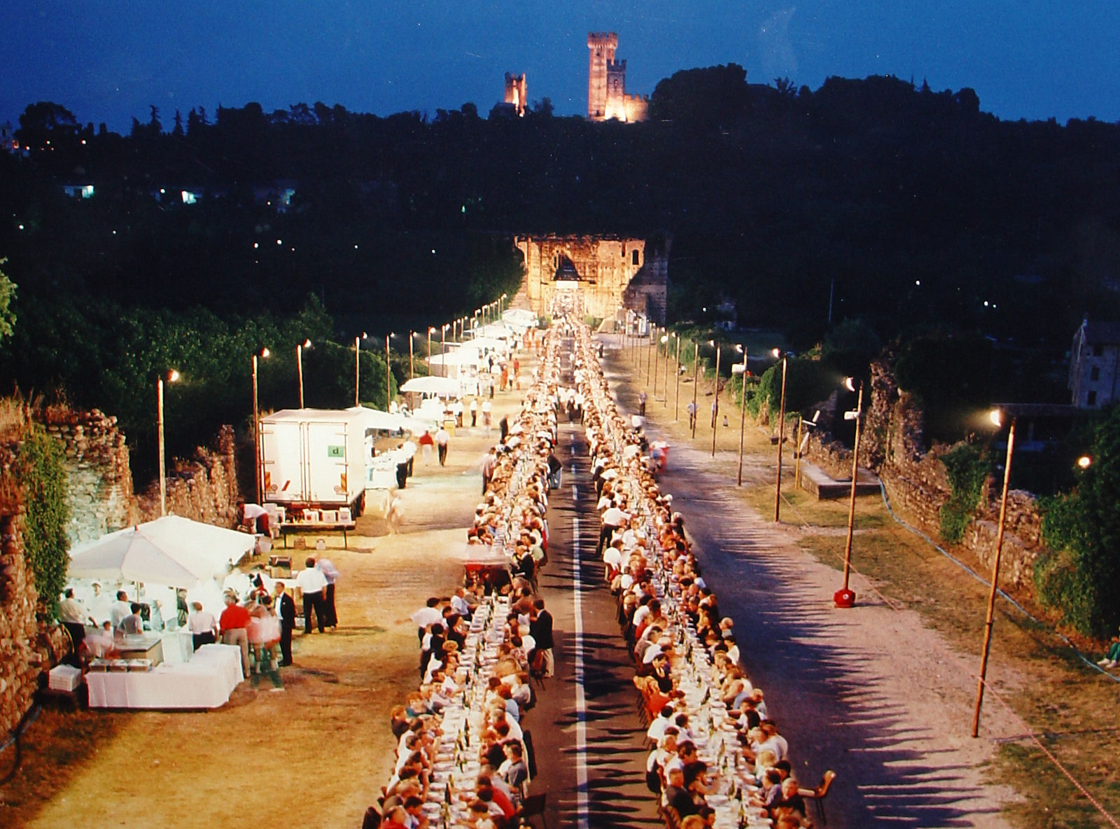 Every third Tuesday in June, the Visconti Bridge hosts 4,000 hungry diners at the Festa del Nodo d'Amore. Photo taken of framed picture hanging in the Ristorante Alla Borsa.