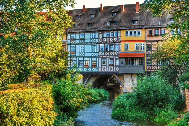 The Krämerbrücke bridge (Merchant's Bridge) in the Thuringian city of Erfurt in Germany which is covered with inhabited, half timbered buildings on both sides, Which make it the longest inhabited bridge in the world.