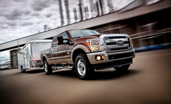 Front 3/4 view of 2011 Ford F-350 towing a trailer