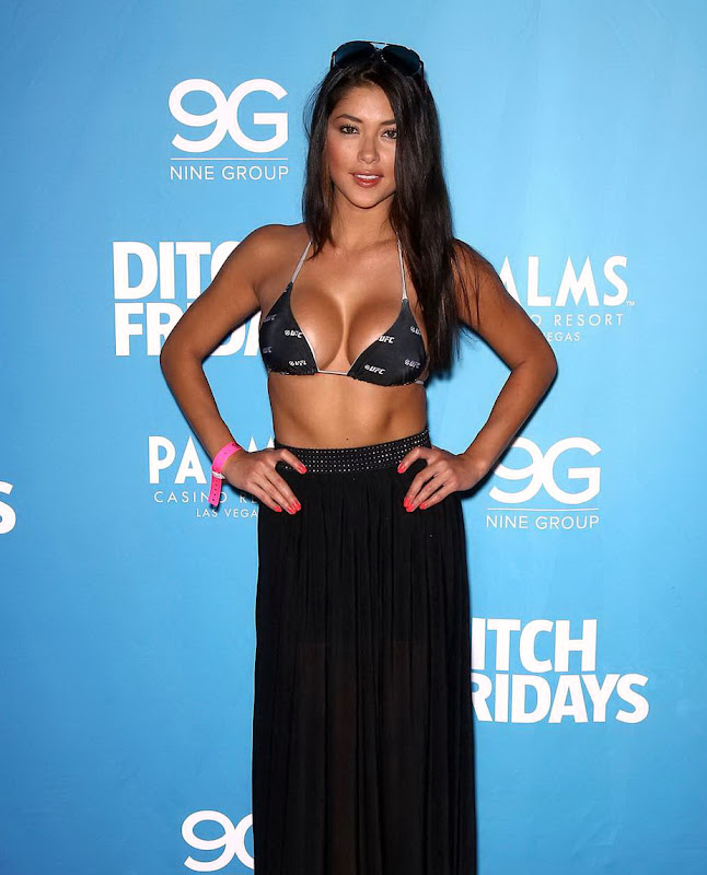 Arianny Celeste wearing a bra and black skirt at UFC Fight Week Party