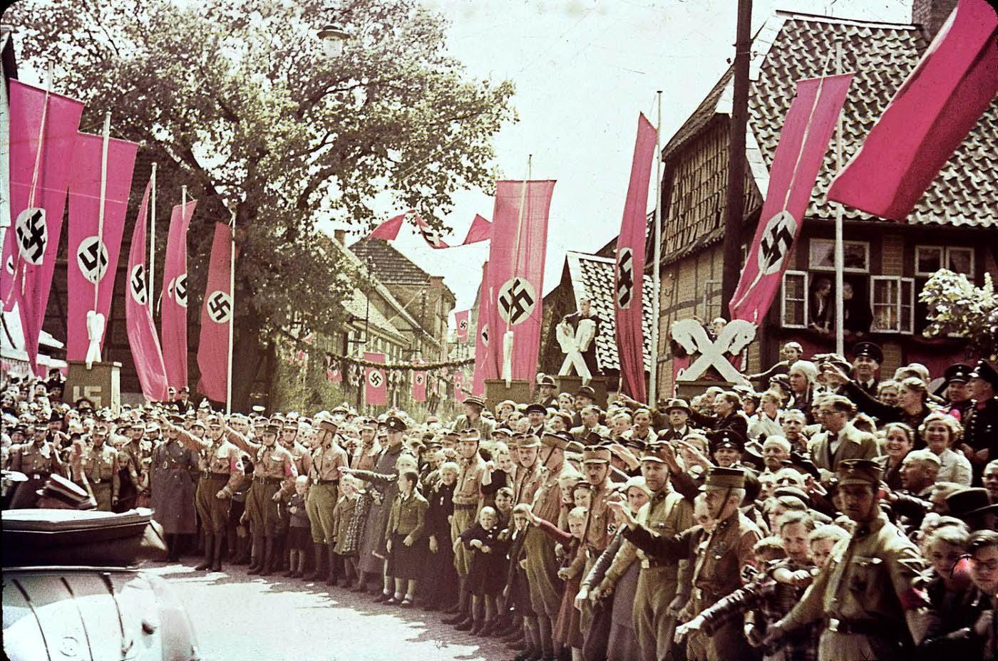 Scene along roadway to the Fallersleben Volkswagen Works cornerstone ceremony, Germany, 1938.
