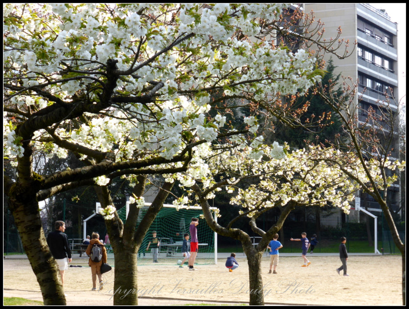 Playing football in Blaise Pascal garden Versailles