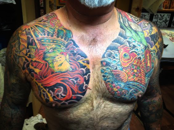 Chest panel pieces of lion and coyfish by tattoo artist Jason Kunz for Triumph Tattoo