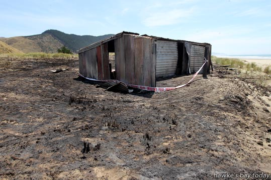 A tin shack on the sand dunes very close to Waimarama Beach, on a property on Waitangi Rd, owned by Hohepa Orikena from Waimarama, but no longer used, was damaged in a suspicious fire on Sunday. The fire just north of Waingongoro Stream also destroyed about 30m by 35m of grasses on the sand dunes. Hastings Fire, Waimarama Rural Fire Force and the Havelock North Volunteer Fire Brigade attended. photograph