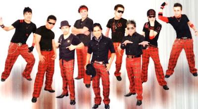 Los Tevez vestidos de rojo y negro
