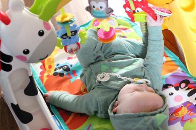 Squidge on the newborn to toddler play mat