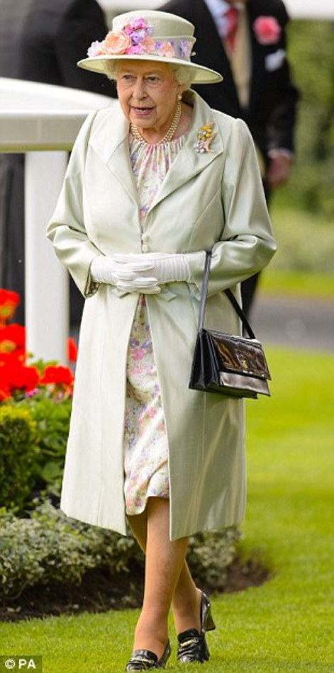 Queen Elizabeth accented her a cream-colored hat and Angela Kelly coat with pastel florals on day 2 at Royal Ascot 2014
