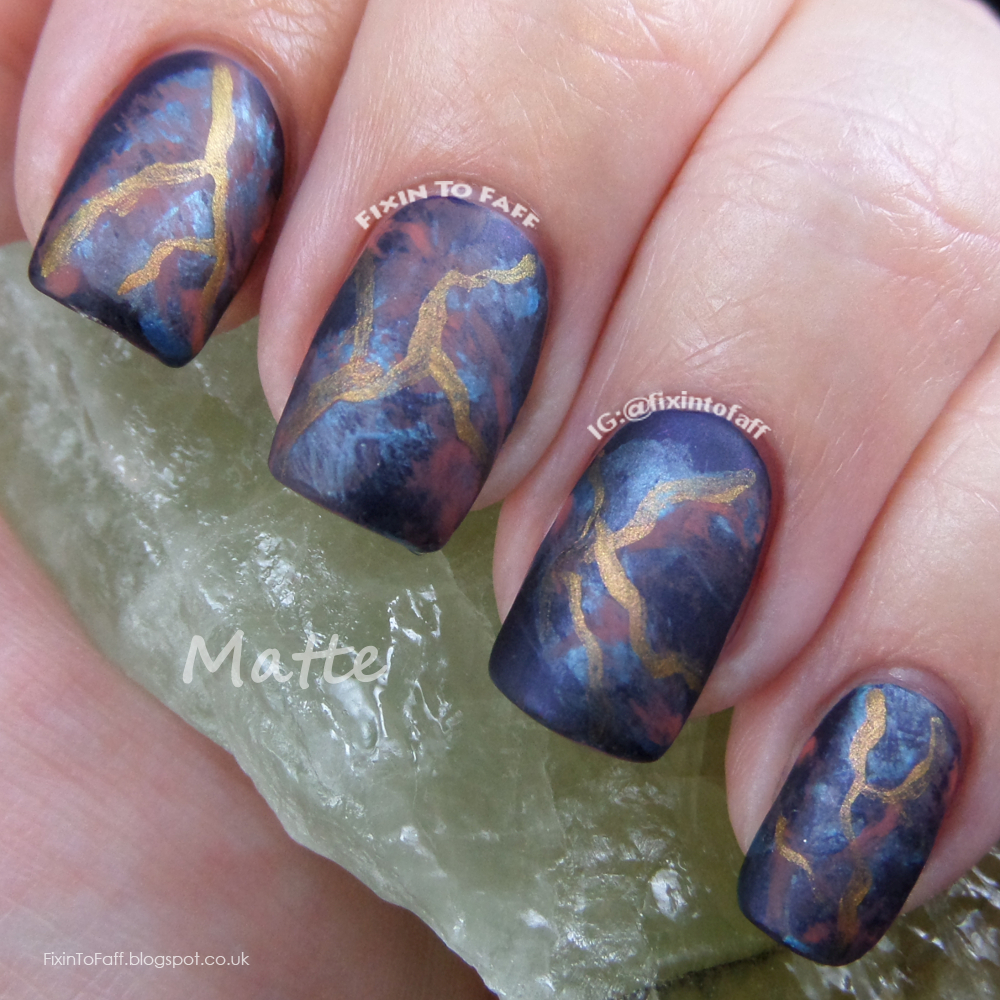 Blue base marbled smoky nail art, evolving from glossy to matte to stamped with dinosaurs.
