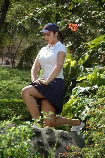charmi kaur in black mini skirt her underwwear seen doing yoga exercise latest hot pics