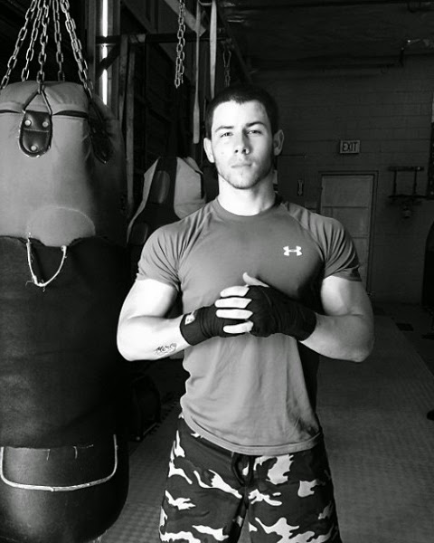 Nick Jonas shares new music and his huge biceps with the world. He may not be naked here, but we'll live with this.