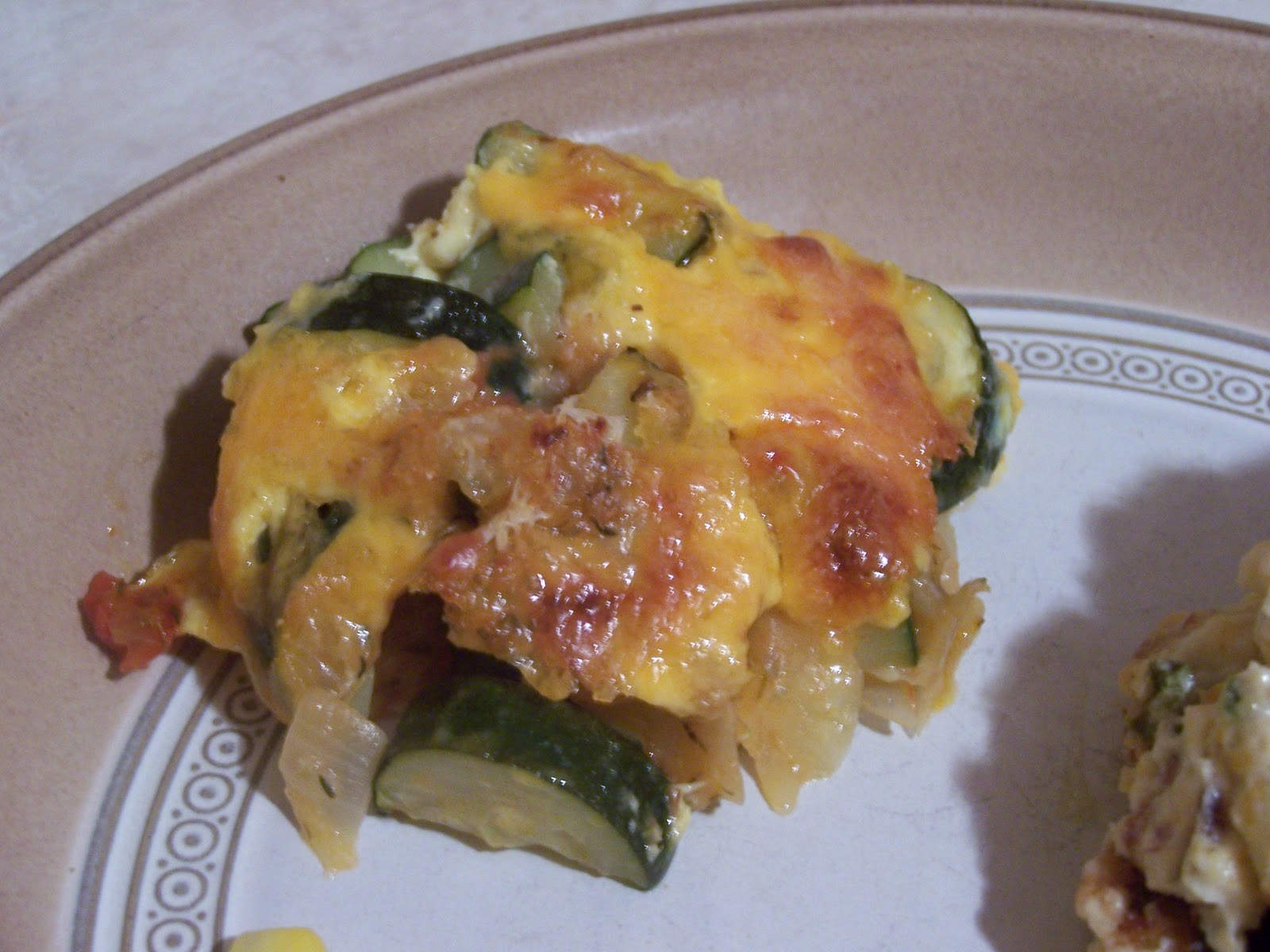 Dutch Oven Madness!: Zucchini Gratin