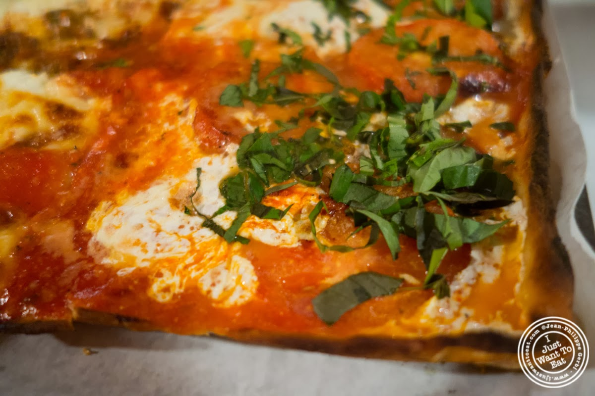 image of margherita pizza at Lazzara's Pizza and Café in the Garment District, NYC, New York