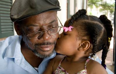 Elderly man and granddaughter