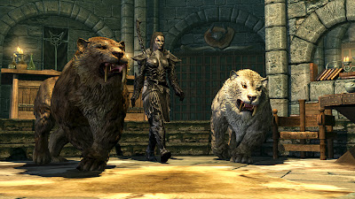 female dragonborn with 2 summoned sabertooth tigers