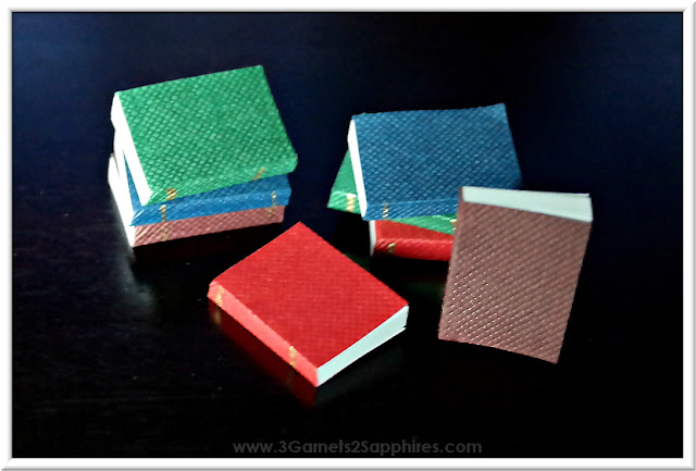 Tutorial for a set of DIY dollhouse miniature books based on your favorite book series.  www.3Garnets2Sapphires.com