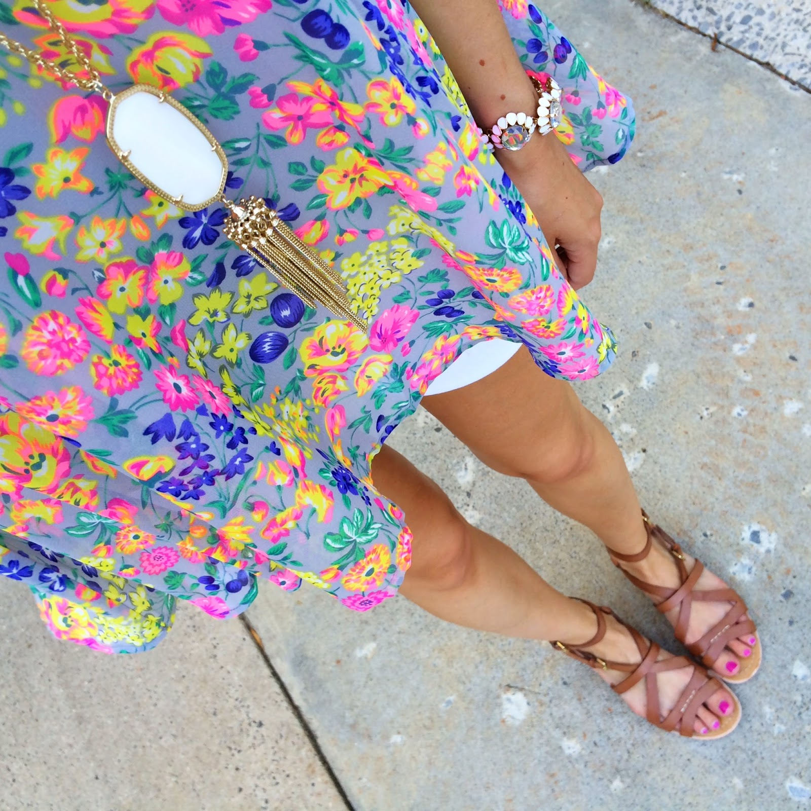 Bright neon tank paired with neutral jewelry and sandals