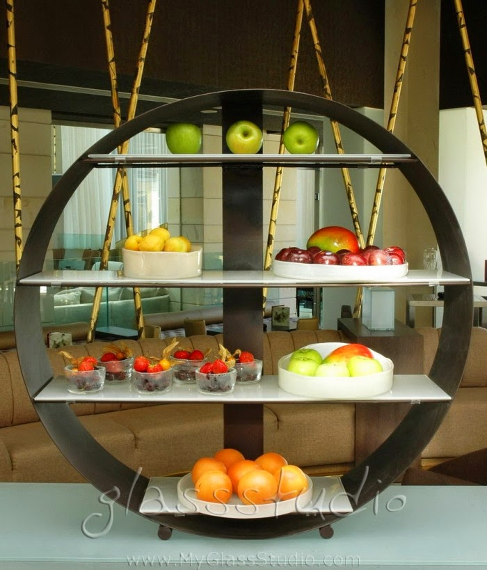 This custom made metal ring holds display shelves for food