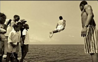 funny pictures black african jumps in water