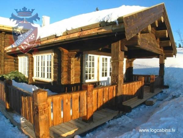 Cabaña de troncos aserrados modelo escandinavo
