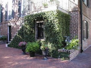 Savannah brick house covered in ivy