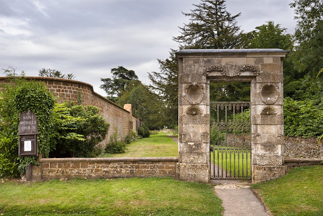 17th-century gateway leading to St. Michael's parish church in Great Tew by Martyn Ferry Photography