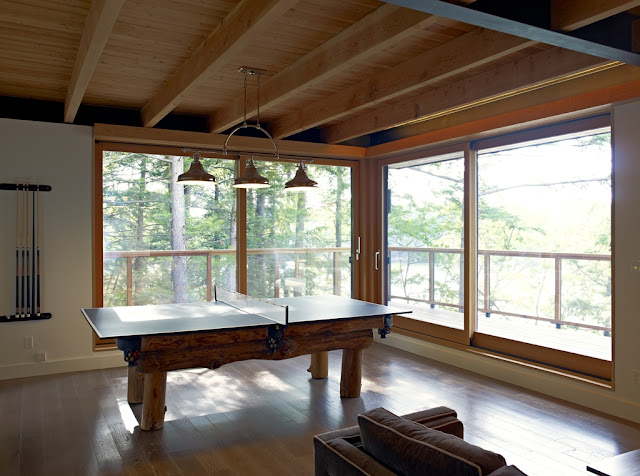Photo of wooden table tennis table in the gaming room of the forest house