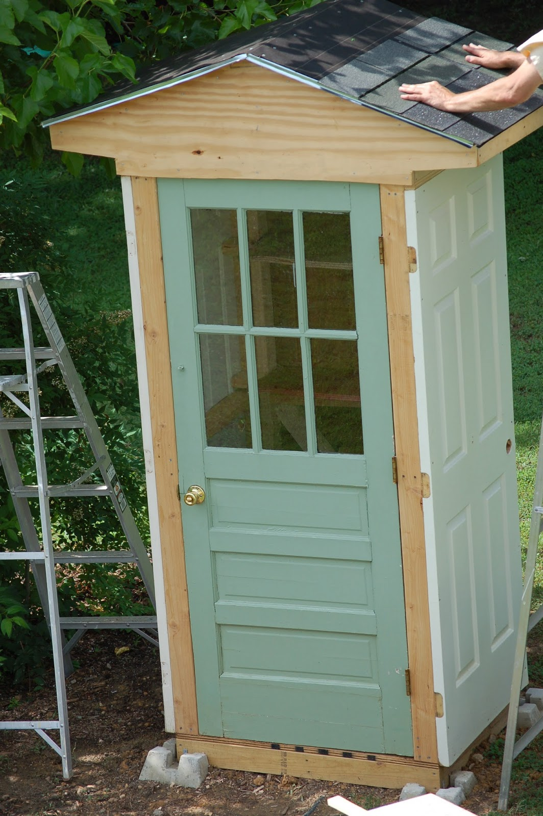 A great garden shed out of old doors home diy fixes for Diy garden shed