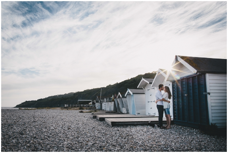 Couple kissing by beach huts