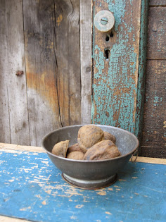 little antique tin with beeswax walnuts $28