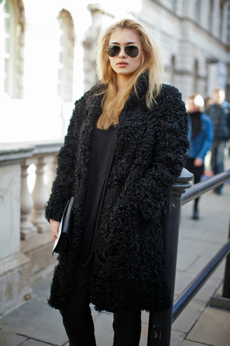 Black boulce furry fur coat model off duty