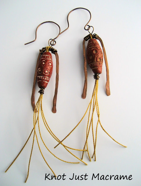 Earrings by Sherri Stokey of Knot Just Macrame using handcrafted brass findings, trade beads and cord.