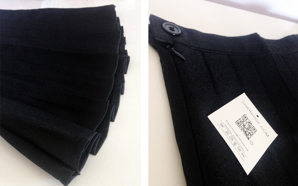 Closeup of the button and zip closure as well as the pleats of the SheInside high-waisted skirt.