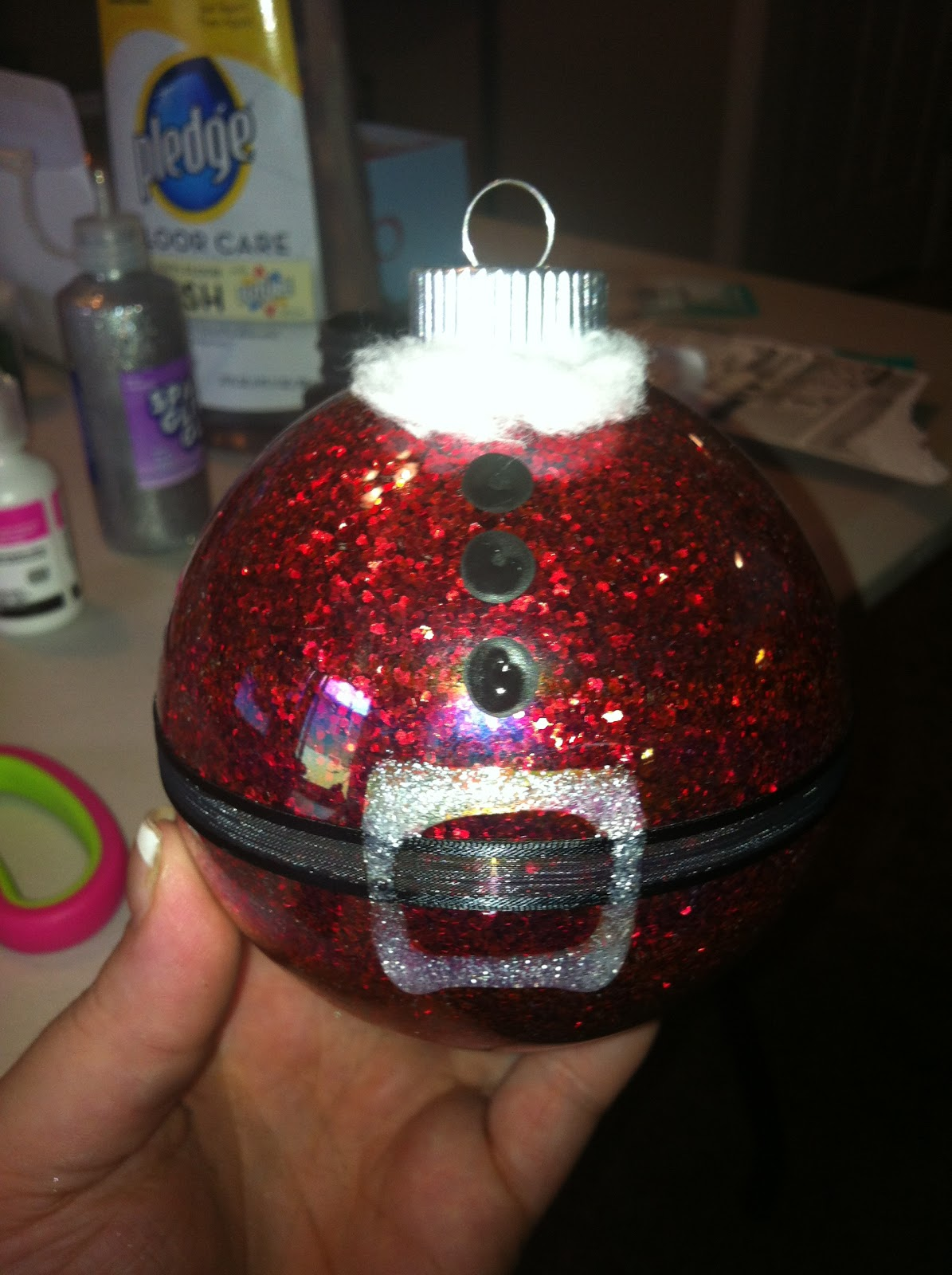-Clear ornament balls -Red Glitter -Pledge floor care(will have a blue lid  and say