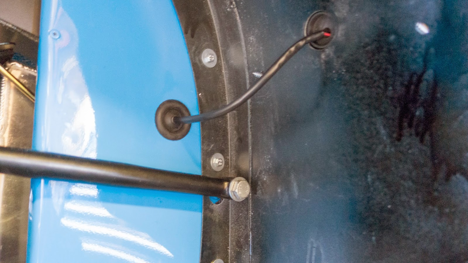 Indicator cabling routed through pre-drilled holes, plugged in behind the bodywork panel and tie wrapped in place.  The rubber grommet fits in the bodywork hole (as pictured) not the wing hole.