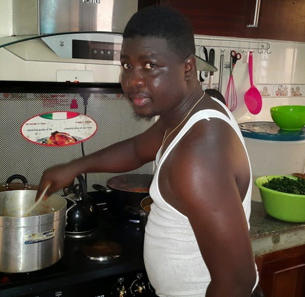 nigerian man cooking wife