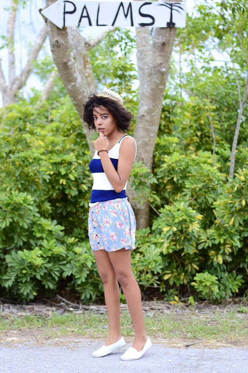 Miami Fashion and Indie Culture Blogger Anais Alexandre of Down to Stars in an American Apparel striped tank with a forever 21 floral skort and Urban Outfitter shoes with a straw fedora from ASOS